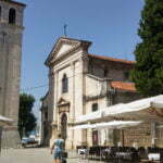 Фасад собора Пулы и колокольня